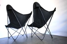 Pair Mid Century butterfly chairs with new black covers