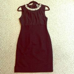 Taylor black dress NWOT Beautiful black Taylor dress with pearl collar. Ties in back of neck and has a hidden zipper in back. Has never been worn. Taylor Dresses