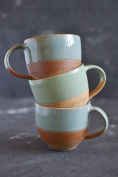 Terracotta coffee cup with green blue glaze