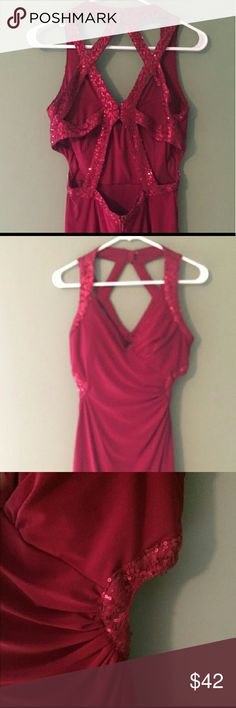 TGIF SALE STUNNING Red Cocktail Dress 9/10 Absolutely beautiful red strappy cocktail dress. So flattering and looks amazing on. Sequin strappy back as shown. Clips at neck in center and back. Zips up side. At neck there is tqo clips and one of them is missing but it is still perfectly secure. Cutout on sides can be seen from the frony. Size 9/10 but would fit a 7/8 too. Worn one time like new.   Smoke and pet free home. Same day shipping. Bundle for a discount. Happy poshing !  Adrianna…