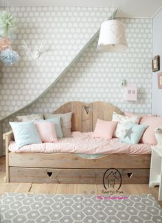 Lovely wooden day bed for girls, with pink and blue cushions