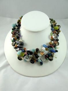 Assortment of Semiprecious Briolette Necklace by Ronnie7 on Etsy, $325.00  This is my best selling necklace for over 8 years, each necklace is one of a kind.  It retails for over $1500, I as the wholesaler/ producer of the necklace am selling it for the great price of $325.  It is made with semi-precious briolettes of amazonite, amethyst, olive jade, rock crystal, black onyx, smokey topaz, yellow citrine, rose quartz, turquoise, labradorite, lapis, mother of pearl, assorted pearls and many…
