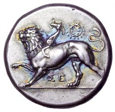 Image 1: Greek Stater from Sikyon, Peloponnessos, c. 350-330 BCE. Obverse: Chimera advancing left, right paw raised, SE below, wreath above. Numismatically, Sikyon was the most productive city of Peloponnese. Its coinage appeared in the beginning of 5th century BCE and greatly increased at 400 BCE. Their high production continued till the times of the Roman conquest in 146 BCE.