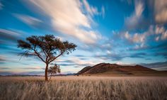 Photo © Mark Dumbleton's photographs of Namibia often pop up in photography and travel magazines – and it's no wonder. See & Read more on Travel Magazines, Pop Up, Travel Guide, Sunrise, Travel Photography, Scene, Clouds, In This Moment, Mountains