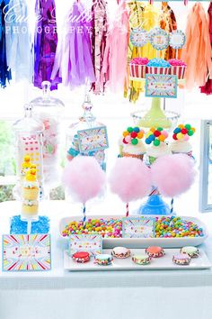 love the cotton candy on stripey straws and base filled with brightly colored sixlets - could also use gumballs.  Balloon clusters in cupcakes are uber cute, too. Also love the rubber ducks on cupcakes