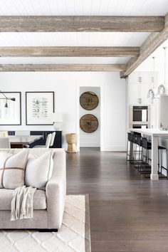 Simple, patterns, rug, open Rustic box beams on the ceiling paired with white tongue and groove + trellis rug pattern + large artwork in the dining area + open floor plan Home Living Room, Living Room Designs, Living Room Decor, Living Room Ceiling Ideas, Rustic Living Rooms, Living Room Artwork, Living Room Flooring, Apartment Decoration, Room Decorations
