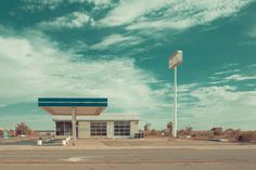 A disused petrol station on a deserted highway.