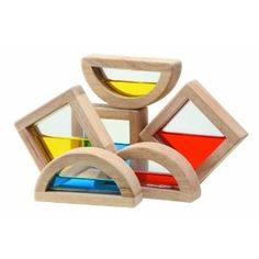 Cool blocks!  Overlay blocks to learn about mixing colors, use the liquid as a level to learn about balance as you build, shine a light through your completed tower to reflect colors on the wall...love this open-ended toy!