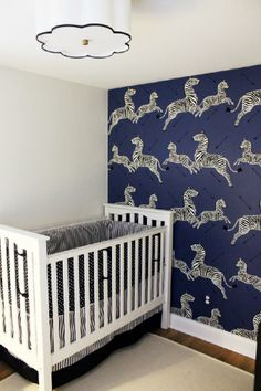 This zebra wallpaper is the perfect accent to this small nursery