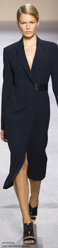 Boss  Always love a coat dress. This is gorgeous. Our Topless Tee women's undershirt would protect this dress invisibly.
