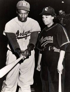 """Jackie Robinson poses with Connie Morgan of the Negro League Indianapolis Clowns. Connie was one of three women to play in the Negro Leagues, along with Toni Stone and Mamie """"Peanut"""" Johnson."""