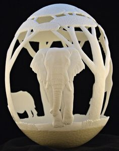 Deviant Artist eggdoodler carves the most amazing sculptures out of delicate egg shells. For this piece, entitled Africa, he used a large Ostrich egg as the canvas for the nature-inspired work. It features three extremely detailed animals—an elephant, a giraffe, and a rhinoceros—roaming the wild. - My Modern Met
