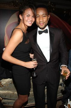 JOHN LEGEND in a tuxedo with wife