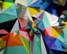 Created by Nuria Mora, this fantastic installation was created for the ARCO fair and includes dozens upon dozens of geometric paper shapes.