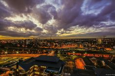 The view from Spinningfields,Manchester,England.The Spire of Salford Cathedral can be seen in the center of the horizon. Manchester United Stadium, Visit Manchester, History Of England, Northern England, Salford, Twilight, Paris Skyline, The Good Place, Cathedral