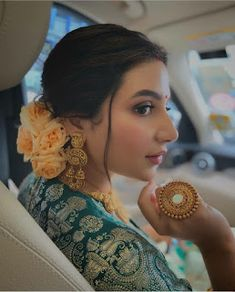 We are obsessed with this look The pretty floral bun striking earring and that big ring in hands is looking absolutely gorgeous Indian Bridal Outfits, Indian Bridal Fashion, Indian Fashion Dresses, Bridal Looks, Bridal Style, Bridal Makeup Images, Saree Hairstyles, Indian Hairstyles For Saree, Bridal Hairstyles