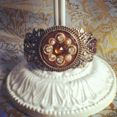 Vintage button, crystals and pearls cuff bracelet.