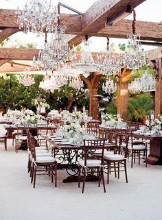 Wood beams, skylight, chandeliers~ Rustic Glam Style!