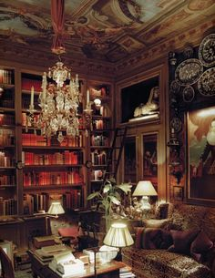 This room is a slice of heaven. Library, ceiling painting, crystal chandelier, wood bookcases, desk, just so elegant  Image: Mark D. Sikes