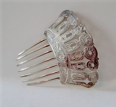 "Vintage 1870s Engraved Sterling Silver Hair Comb   Engraved on the front and back with a very intricate pattern, this Sterling Silver hair comb is a real beauty.  The design is so intricate and detailed with open cutouts.  There is no maker's mark but this is one of the best!  A great collector's item, too!    Condition: Excellent  Measurement: 4 1/2"" x 4"""