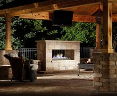 A fireplace from the Belgard Elements Collection can turn an outdoor space into an outdoor room.