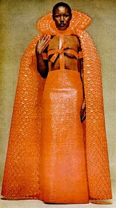 Grace Jones in Courrèges, 1974 OMG Orange Bubblewrap. now I understand why gaga prays at the altar of St Disgrace. Bow down..
