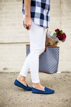 navy buffalo check blouse, white jeans and navy slipper loafers.