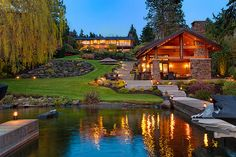 Talk about HUGE!! A lake. A cool house. A super cool backyard. Awesomeness at its best! I love this