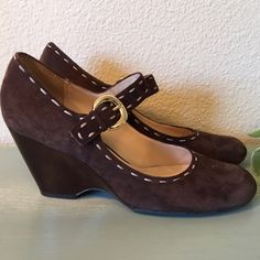 """Franco Sarto Brown Suede Mary Janes These are an adorable twist to the Mary Jane. brown suede with brown patent leather wedges and light brown stitching and gold buckles for accent. The heel height is 3"""". Franco Sarto Shoes Wedges"""
