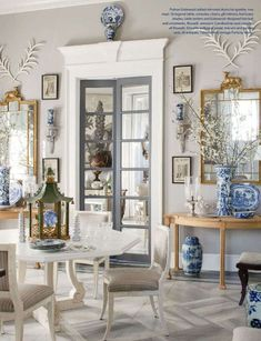Love this eclectic, classic space with French Country furnishings and chic blue and white ginger jars. #kathykuohome