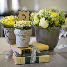 like this centerpiece done in pops of yellow and grey!