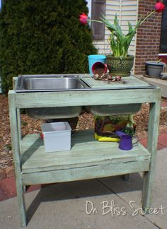 Yes. Yes. Yes! Find an old sink, build a frame and add a hose hookup and bucket. This is it! How You Can Make This Awesome $5 Garden Potting Stand!