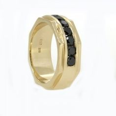 Yellow gold and diamond handmade mens wedding ring, 7 x 3.5mm round black diamonds in channel setting, 9.00mm wide band x 2.7mm deep with stepped edge, octagon side shape and polished finish.