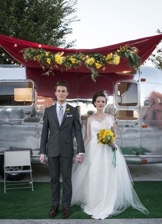 An airstream wedding. Vintage inspiration with sunny yellow flowers. Loved this garland decor!