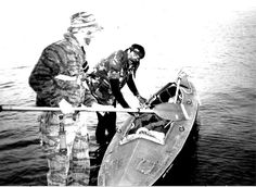 soldiers in kayaks | TOC with Klepper preparing for Op. Doc Kyle smiling for Camera and PO ...
