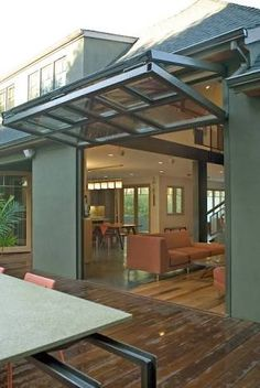 Breezeway's airplane hangar doors for residential - nice to not have the interior overhead track
