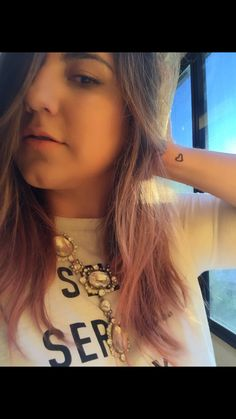 Pink hair... And heart tattoo