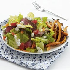 Delicious and healthy salad and sweet potato fries.  Very easy homemade bleu cheese dressing recipe included.