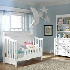 This classic crib looks great in this blue nursery design!