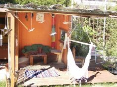 A rustic kid's play house built with flea market finds and scratch   Offbeat Families