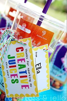 Print off the printable below.  Cut out the tags.  Punch a hole in the corner of the tags and string ribbon through.  Have your child sign their name.  String the tags through the ribbon and tie on the cup.  Fill the cup with candy and a gift card.