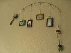 Use fishing pole to hang pictures!