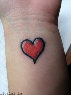A cute and simple heart tattoo design on the wrist. Red is the traditional color for a heart tattoo, though there is no rule that says heart tattoo designs must be red and it's up to the client to choose which color they prefer. Simple Tattoo Designs, Tattoo Designs Wrist, Tattoo Designs For Women, Tattoos For Women Small, Small Tattoos, Wrist Tattoo, Love Heart Tattoo, Black Heart Tattoos, Simple Heart Tattoos