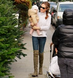 Tamara Ecclestone.. Duffy Cable Knit Turtleneck Sweater, Stuart Weitzman Lowland Boots, and Rolex Cosmograph Daytona Watch..