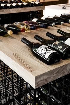 Freestanding Open Wire Display Frames Allow A Dynamic Storage Pattern Under Indi. Freestanding Open Wire Display Frames Allow A Dynamic Storage Pattern Under Individually Routed Timber Blocks That H Wine Display, Bottle Display, Bottle Shop, Wine Cellar Design, Wine Design, Tasting Room, Wine Tasting, Wine Shop Interior, Bar A Vin