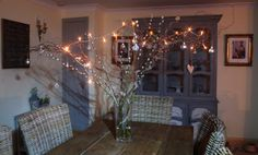 My rustic Xmas table centre piece made from contorted willow, pussy willow, battery fairy lights and a few baubles.