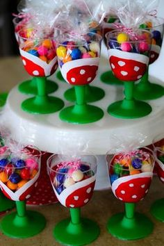 Handpainted Pirhana cups filled with gumballs.