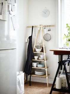 "Japanese designer Keiji Ashizawa says of his leaning wall shelf ($49.99), ""With my furniture, you can enjoy small spaces, make good use of corners, and keep things organized at the same time."" Ikea PS 2014 