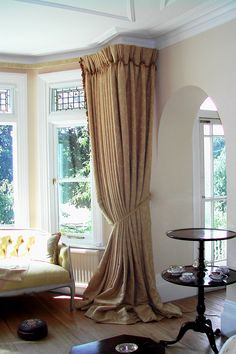 Buy curtains with a slightly longer length and let them pool onto the floor to create this truly luxurious effect.  Although this fabric gives the effect of a block colour it is actually a gold damask. When buying such fabric take note of the size of the pattern: usually the bigger patterns suit a bigger window.  Perfect for period homes or where you just want to create an understated elegance. The trim down the leading edge gives them more of a homely feel.
