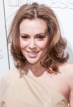 Alyssa Milanos shoulder-length, wavy hairstyle